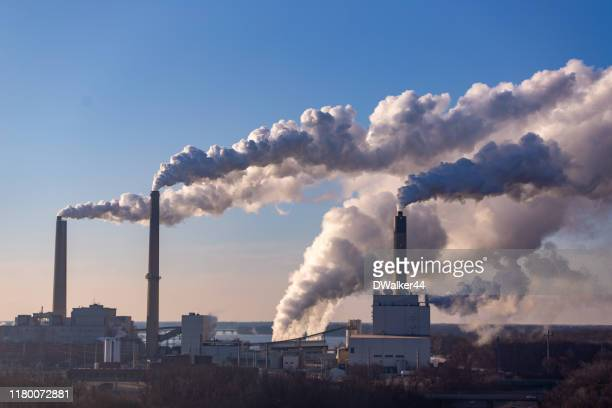 wind blowing pollution - pollution stock pictures, royalty-free photos & images