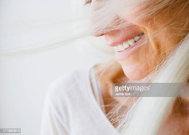 wind blown senior woman, smiling - white hair stock pictures, royalty-free photos & images