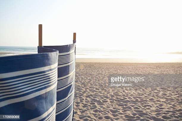 wind break on beach. - windbreak stock pictures, royalty-free photos & images