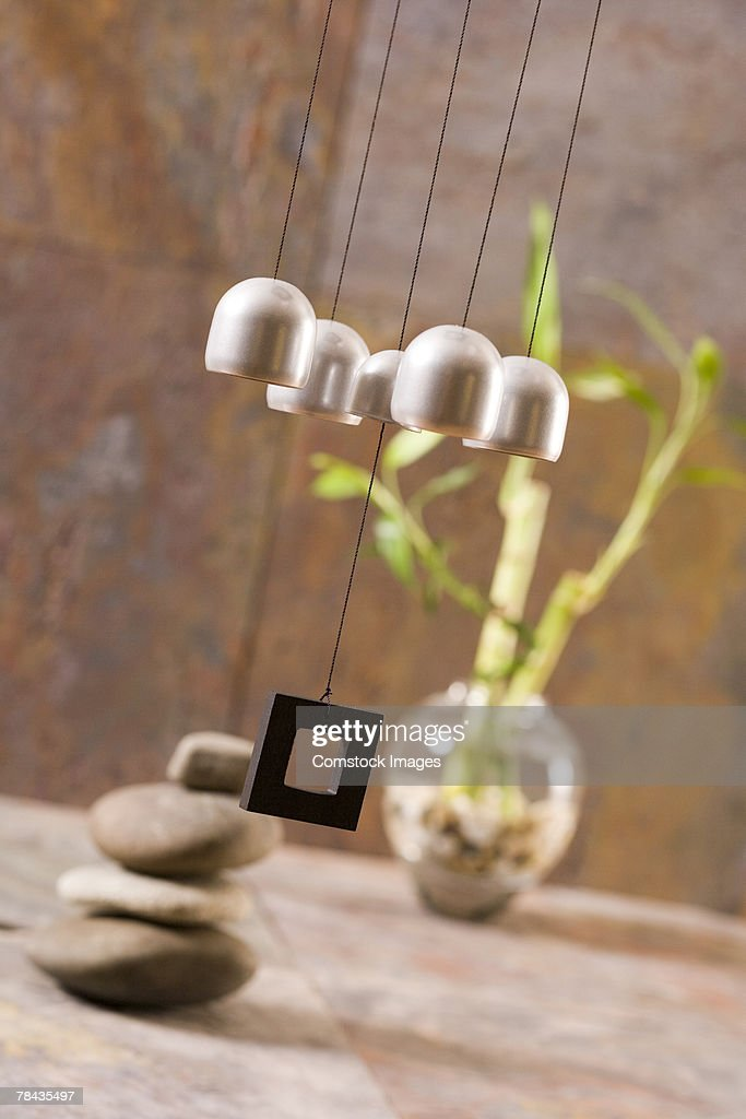 Wind chime, plant, and stones : Stockfoto