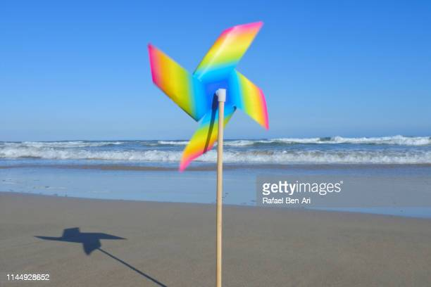 wind fan toy rotating at the beach - rafael ben ari stockfoto's en -beelden