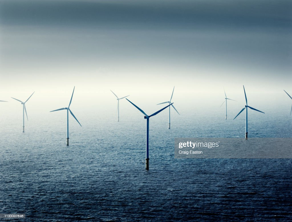 Wind farm at sea : Stock Photo