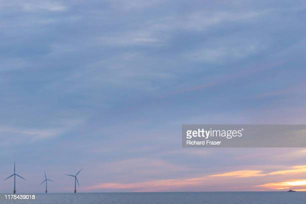 wind farm at sea - windmill stock pictures, royalty-free photos & images