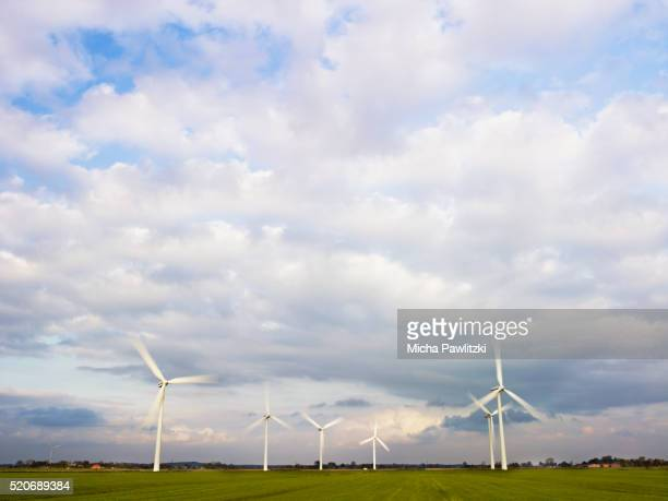 wind farm in meadow in northern germany - husum stock-fotos und bilder