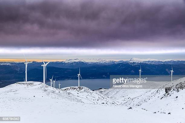 Wind Farm in Snow at Colorful Sunset
