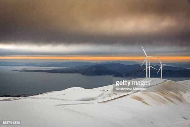Wind Farm in Snow at Sunset