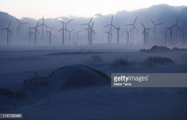 A wind farm operates as sand blows in the Coachella Valley on May 7 2019 in Palm Springs California California's Fourth Climate Change Assessment...