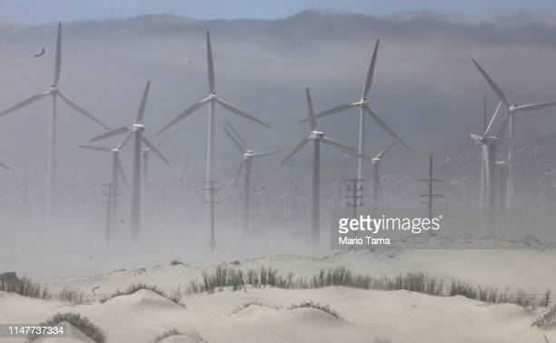 A wind farm operates with wind turbines as sand blows in the Coachella Valley on May 7 2019 in Palm Springs California California's Fourth Climate...