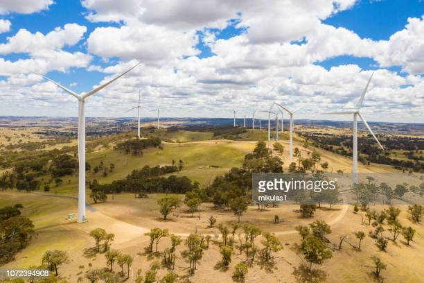 wind farm out in a paddock. - wind power stock pictures, royalty-free photos & images