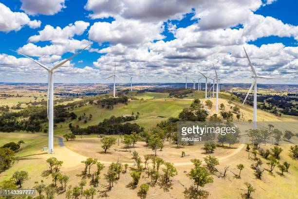 wind farm out in a paddock. - sustainable energy stock pictures, royalty-free photos & images