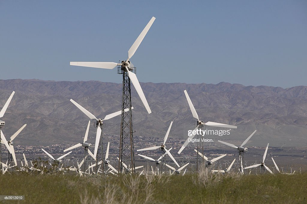 Wind Farm with Mountains in the Background : Stock Photo