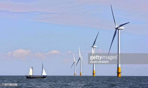 A wind farms off the coast of Whitstable on the Kent coast in southeast England is pictured 11 July 2006 on the day that the Bih government publishes...