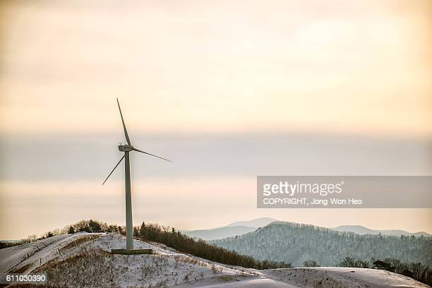 A wind generator on the mountain covered with white snows