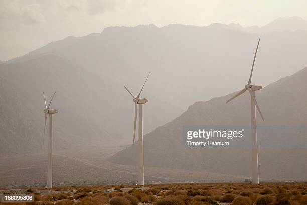wind generators and mountains in fog - timothy hearsum stock pictures, royalty-free photos & images