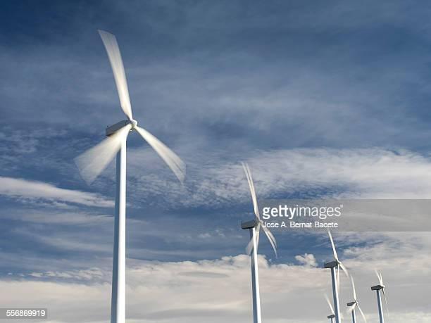 Wind generators in movement on a blue sky