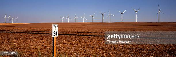 wind generators on edge of plowed field - timothy hearsum stock pictures, royalty-free photos & images