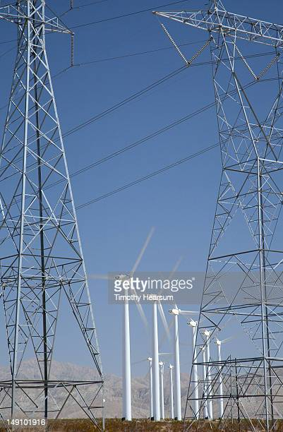 wind generators seen through pylons and cables - timothy hearsum stock-fotos und bilder