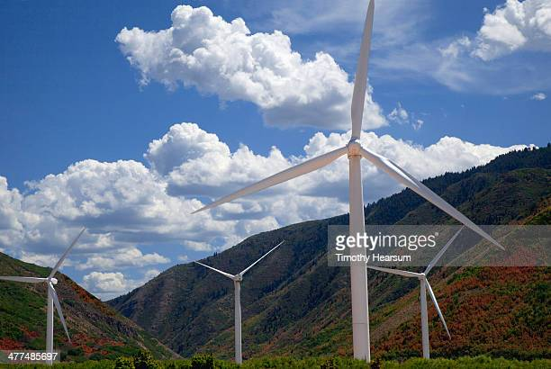 wind generators situated in mountain pass - timothy hearsum stock photos and pictures
