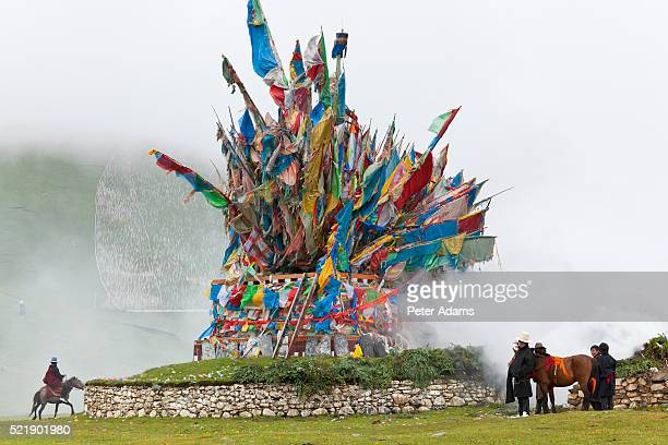 wind horse of buddhist prayer flags at horse festival nr daofu, tibetan area, sichuan, china - peter adams stock pictures, royalty-free photos & images