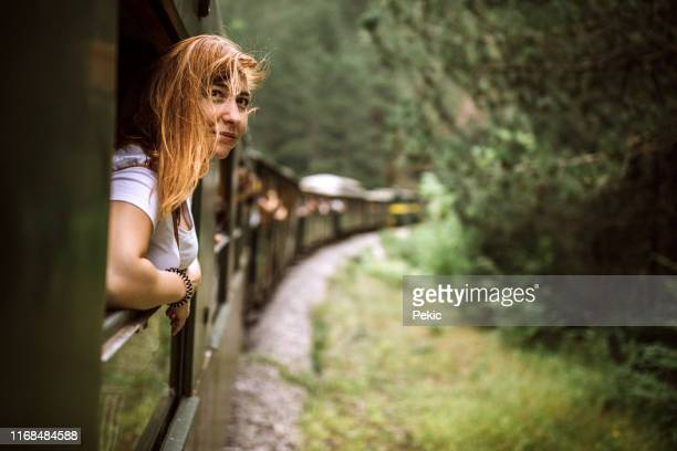 wind in her hair on train adventure - serbia stock pictures, royalty-free photos & images