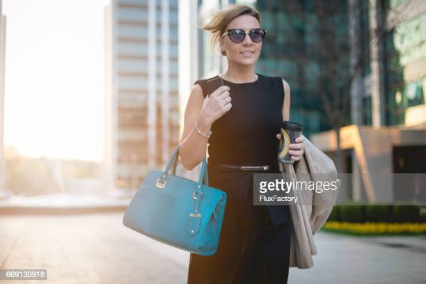 wind in my hair and success in my hands - clutch bag stock pictures, royalty-free photos & images