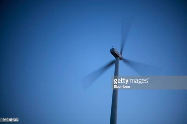 A wind mill installed by Suzlon Energy Ltd turns in the wind in Dewas India on Tuesday Feb 10 2009 Plans for building hundreds of projects to curb...