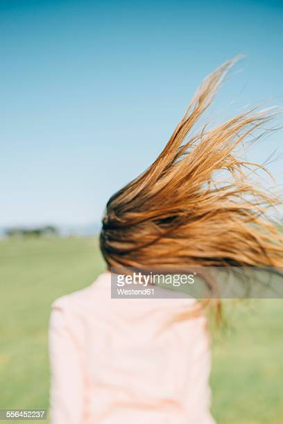 Wind moving long hair of a woman