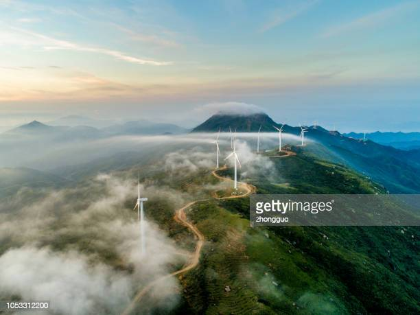 wind power generation - windmills stock photos and pictures