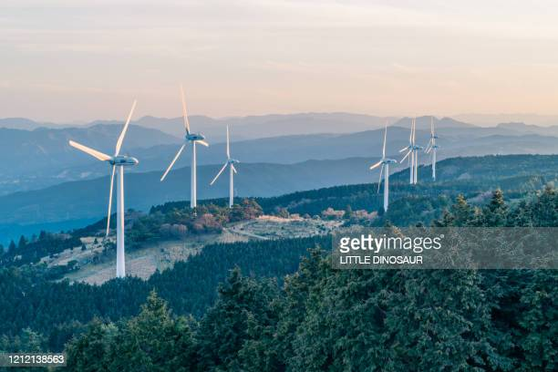 wind power generators standing on the top of the plateau - 風力発電 ストックフォトと画像