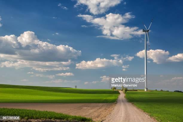 Wind power plant between fields. Masuria. Poland