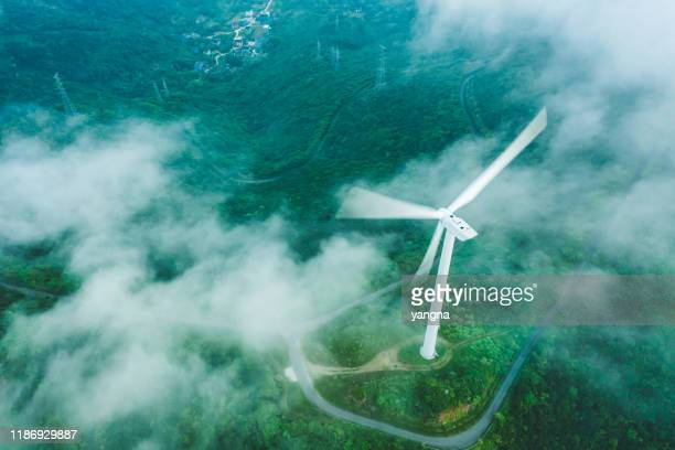 wind power station on the mountain - climate change stock pictures, royalty-free photos & images