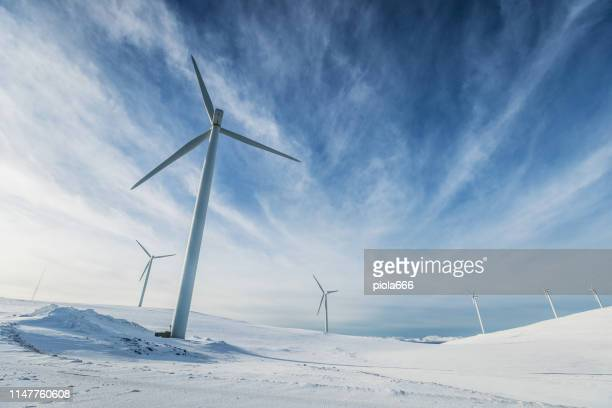 wind power sustainable resource in the arctic - northern norway stock pictures, royalty-free photos & images