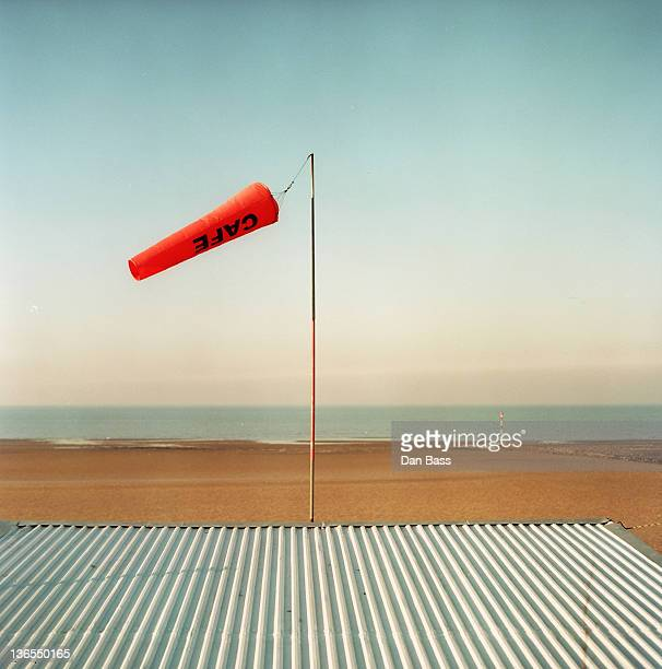 Wind sock flies above beach cafe