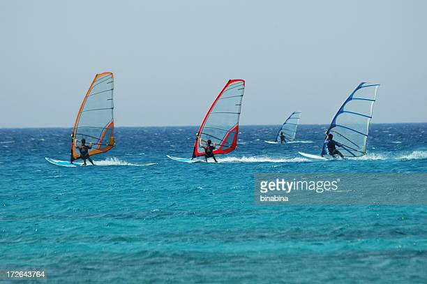 wind surf race - windsurfing stock pictures, royalty-free photos & images