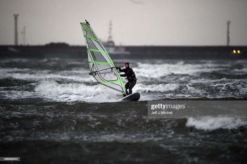 Wind surfer Alan Jackson battles with the weather at Barassie beach on November 13, 2015 in Troon, Scotland. Storm Abigail has closed schools on the Western Isles and ferries have been cancelled as gale force winds overnight left 12,000 properties without power.
