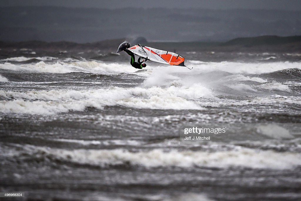 Wind surfer Douglas Paton battles with the weather at Barassie beach on November 13, 2015 in Troon, Scotland. Storm Abigail has closed schools on the Western Isles and ferries have been cancelled as gale force winds overnight left 12,000 properties without power.