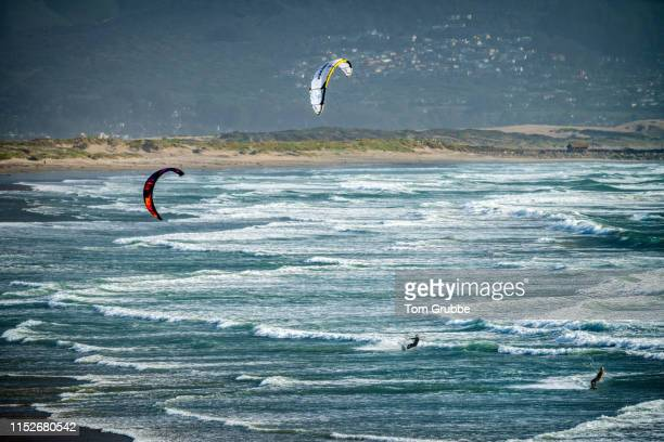 wind surfers - tom grubbe stock pictures, royalty-free photos & images