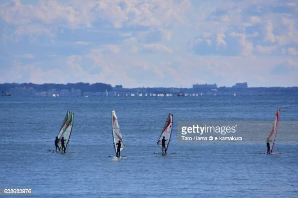 Wind surfing practices on the silent beach