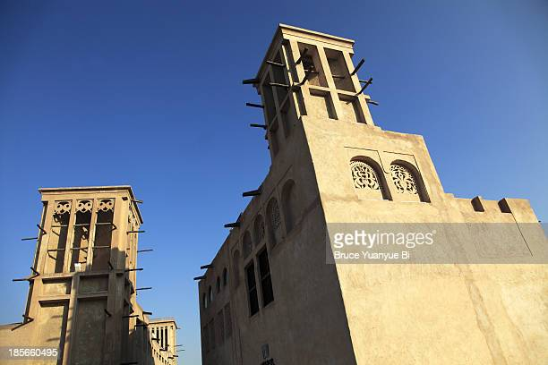 wind towers and traditional house in ai bastakiya - tradition stock pictures, royalty-free photos & images