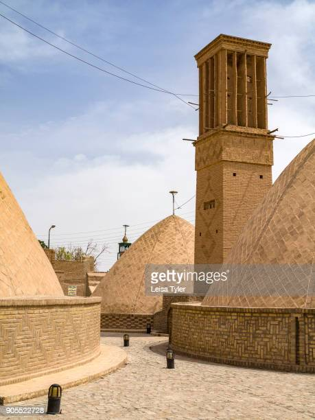 Wind towers used to keep the town municipal water cool in Naein Iran Wind towers or windcatchers are a traditional Persian architectural element to...