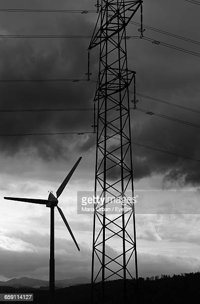 Wind Turbine Against Dark Cloud