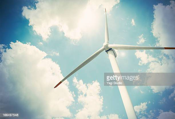 wind turbine and blue sky, view from below - 風力発電 ストックフォトと画像
