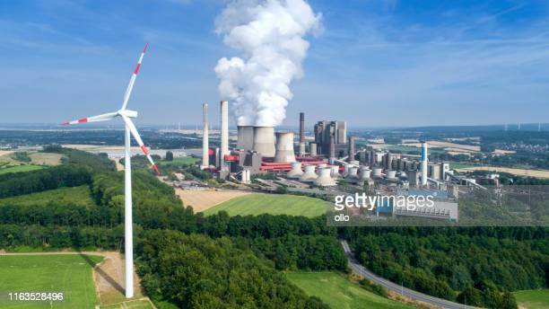 wind turbine and coal power station - coal stock pictures, royalty-free photos & images
