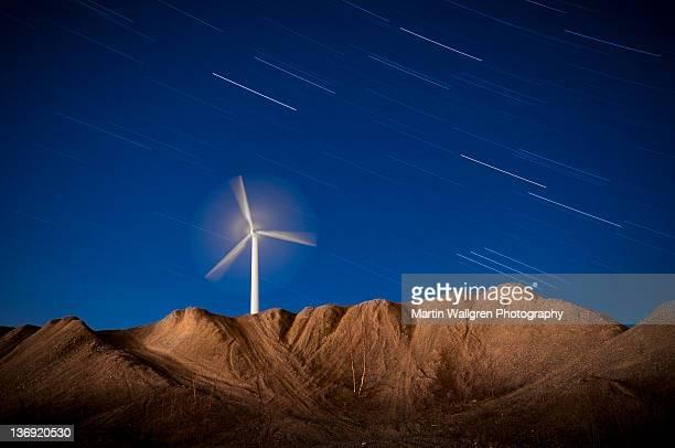 Wind turbine and moonlit landscape