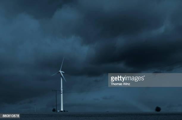 wind turbine and power lines - wetter stock-fotos und bilder