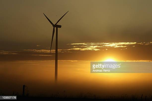 A wind turbine at sunset is pictured on August 20 2010 in Roedgen near Bitterfeld Germany Germany is investing heavily in renewable energy production...