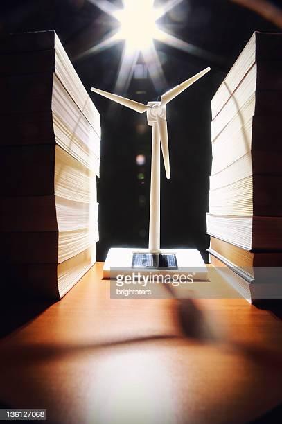 Wind turbine between stack of books