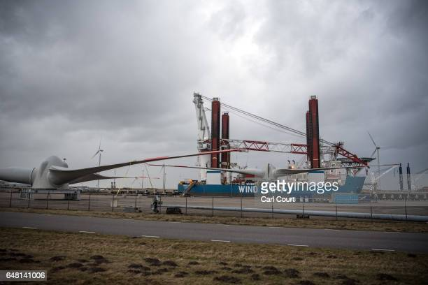 Wind turbine blades are loaded on a vessel on February 23 2017 in Eemshaven Netherlands The Dutch will vote in parliamentary elections on March 15 in...