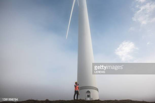 wind turbine engineer, reports on the radio for a damage to the turbine - tower stock pictures, royalty-free photos & images