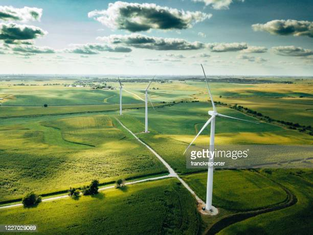 wind turbine farm aerial view - environmental issues stock pictures, royalty-free photos & images